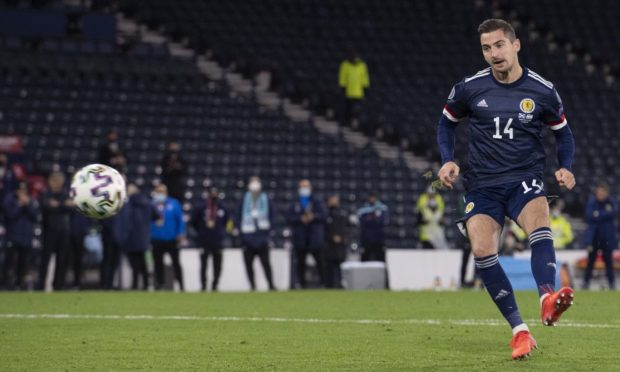 Kenny McLean scores the winning penalty for Scotland against Israel.