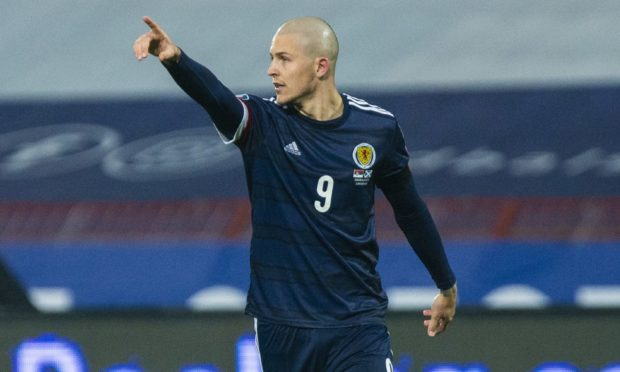 Lyndon Dykes in action for Scotland.