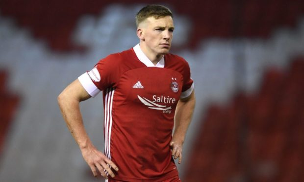 Lewis Ferguson in action for Aberdeen.