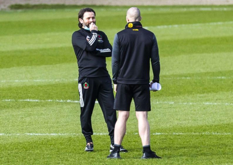 Cove manager Paul Hartley (L) ahead of the match against Partick Thistle.