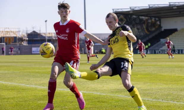 Aberdeen's Calvin Ramsay against and Dumbarton's Jamie Wilson in his first start.
