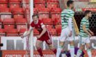 Aberdeen's Lewis Ferguson celebrates making it 1-0 against Celtic.