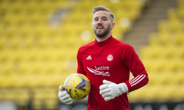 Aberdeen's Gary Woods warms up ahead of a Scottish Premiership match against Livingston.