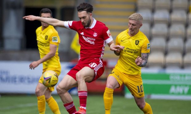 Aberdeen's Connor McLennan and Livingston's Craig Sibbald in action