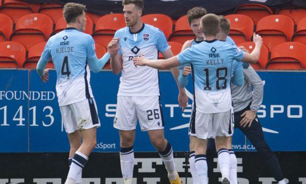 Ross County's Jordan White (centre) celebrates his opener against Dundee United.