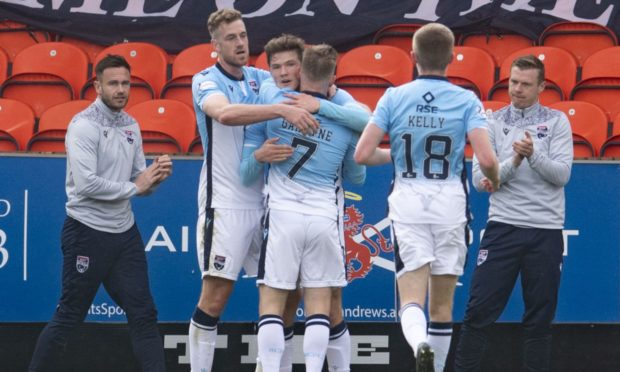 Jordan White (left) celebrates his opener during a Scottish Premiership match between Dundee United and Ross County.