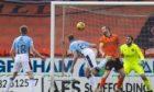 Ross County's Jordan White scores the opening goal against Dundee United.