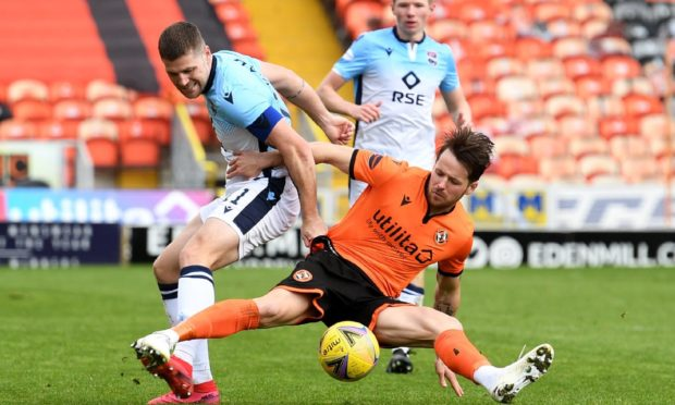 Ross County's Iain Vigurs (left) challenges Dundee United forward Marc McNulty in Saturday's 2-0 win for the Highlanders. Picture by Craig Foy/SNS Group