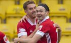 Ryan Hedges celebrates his goal with Tommie Hoban on his return at Livingston