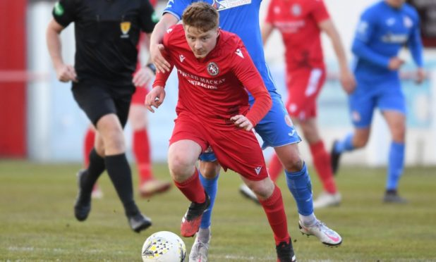 Andy Macrae in action for Brora Rangers.
