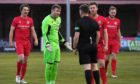 Joe Malin leads the Brora protests after Kelty are awarded a third penalty of the night