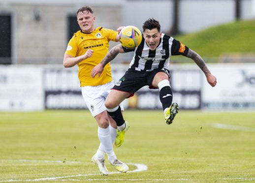Elgin's Archie MacPhee (right) and Edinburgh's Andy Black. Photograph by Roddy Scott/SNS Group