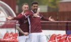 Nathan Austin celebrates after completing his hat-trick against Brora Rangers.