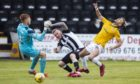 Edinburgh's Ouzy See, right, is challenged by Elgins Darryl McHardy. Photograph by Roddy Scott/SNS Group