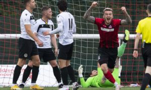 Elgin's Darryl McHardy (R) celebrates scoring against Edinburgh City in the play-offs last season.