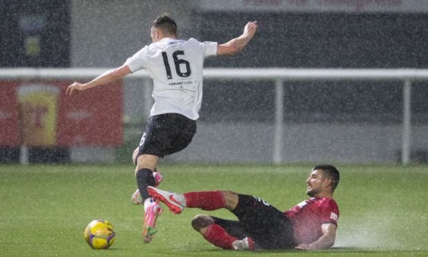 Elgin's Matthew Cooper (R) and Edinburgh's Josh Campbell during the Scottish League One play-off semi final.