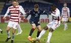 Blair Spittal in action for Ross County against Hamilton.