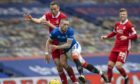 Andy Considine challenges Rangers' Ryan Kent at Ibrox