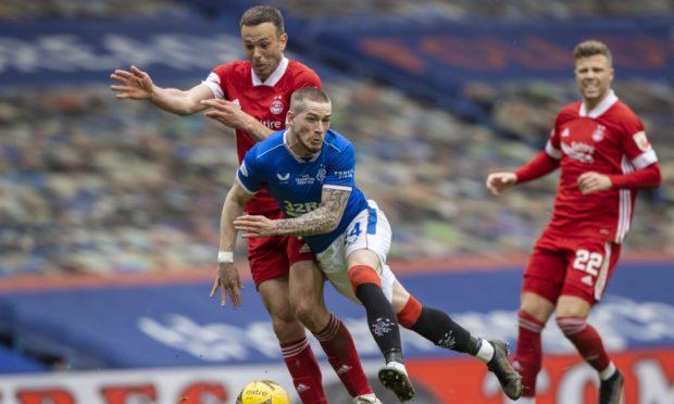 Andy Considine challenges Rangers' Ryan Kent at Ibrox