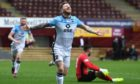 Ross County's Michael Gardyne celebrates putting his side 2-1 ahead against Motherwell in the final game of the campaign - a goal which secured County's Premiership status.
