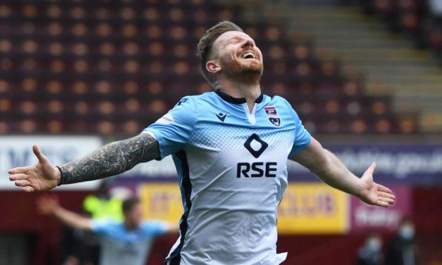 Michael Gardyne celebrates his winner for Ross County against Motherwell.