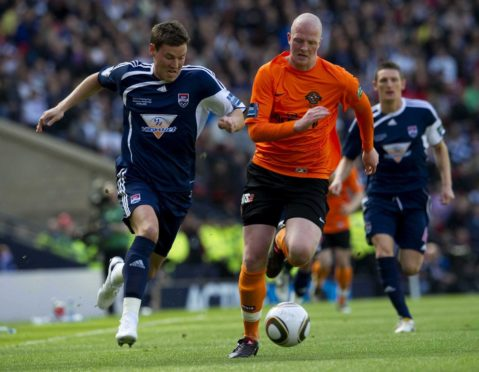 Ross County's Andrew Barrowman (left) gets away from Garry Kenneth in 2010 Scottish Cup final.