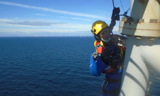 A PD&MS rope access technician working on a wind farm off the coast of Scotland.