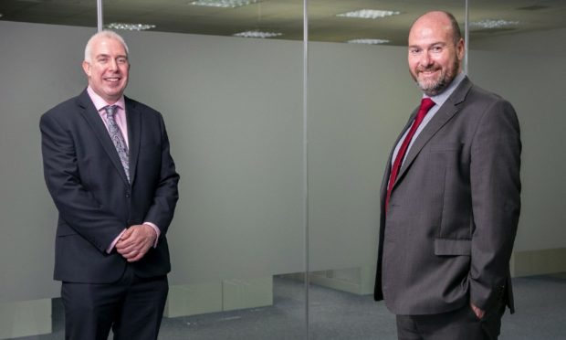 Angus McCuaig, managing partner at Hardie Caldwell (left) and Graeme Allan, chief executive at Anderson Anderson announce a merger of the two firms.