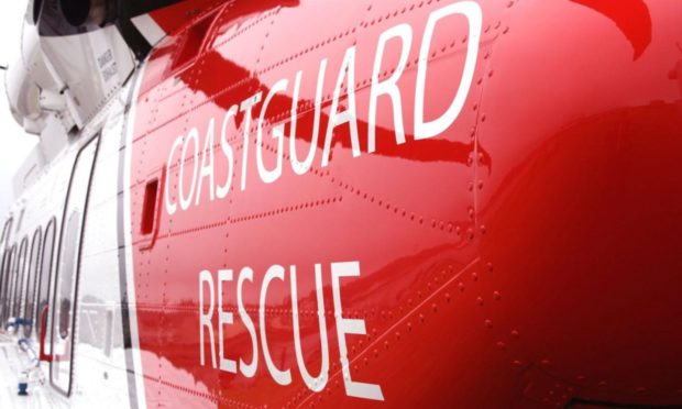 Teams are working to help a vessel that has run aground.