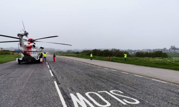 Prestwick Coastguard Helicopter was forced to land at Aberdeen Beach after foggy conditions hampered their ability to land at Aberdeen Royal Infirmary.  Picture: HM Coastguard