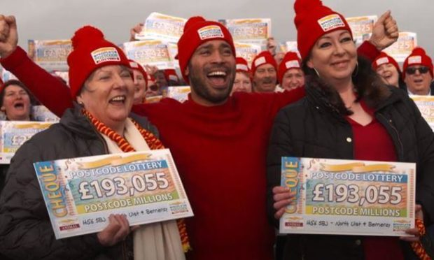 Some of North Uist's Postcode Lottery winners, who recently received their share of £3 million