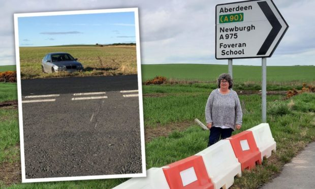 Bollards erected after 'number' of cars overshoot Aberdeenshire junction and end up in field. Cllr Gillian Owen pictured next to the bollards.