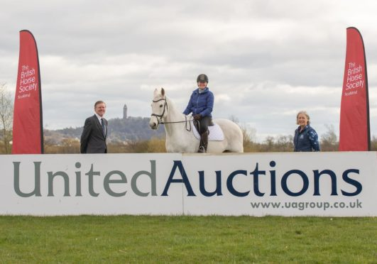 From left: United Auctions' Christopher Sharp, BHS member Shonagh Robb on her horse Platinum Cracker and Helene Mauchlen of the British Horse Society.