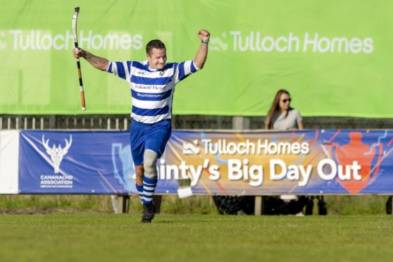 Newtonmore's Glen Mackintosh celebrates one of his goals in the Tulloch Homes Camanachd Cup final against Oban Camanachd in 2019.