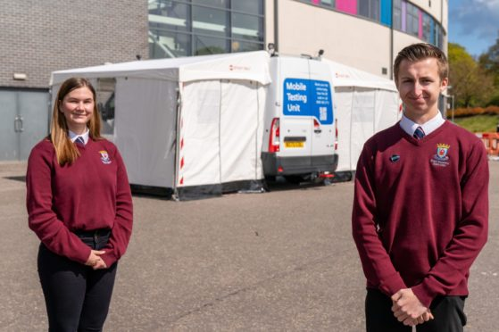 Elgin Academy pupils Isla Hepburn and Rory Stanley on front of the test centre.