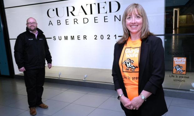 Craig Stevenson, centre manager of Bon Accord & Susan Crighton, director of fundraising for Charlie House, announce the opening of Curated Aberdeen.