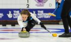 Jen Dodds delivering a stone in Scotland's opening match of the World Mixed Doubles Curling Championship