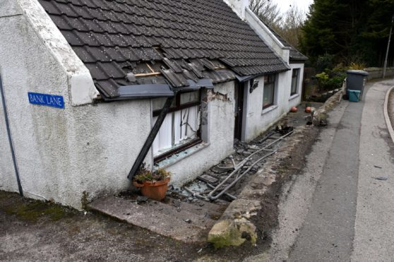 A car crashed into the property in Longside early today