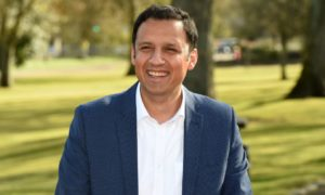 "Anas Sarwar gave the suspended Aberdeen Nine ""encouraging"" support on a campaign visit to the city's Victoria Park"