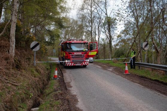 To go with story by Annie Butterworth. Man missing and feared dead after house fire in near Dores Picture shows; Dores hill police cordon. Dores, Inverness. Paul Campbell Date; 04/05/2021