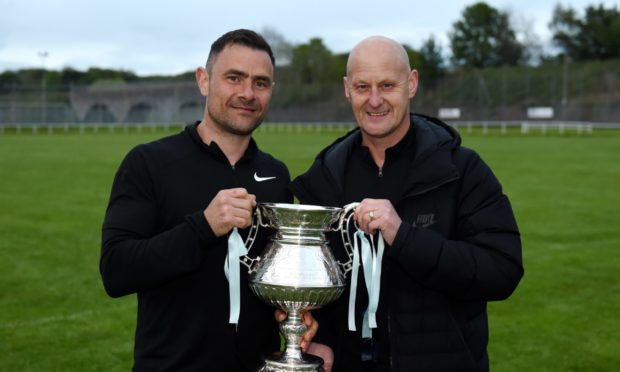 Tommy Forbes, right, with Jamie Watt and the McLeman Cup