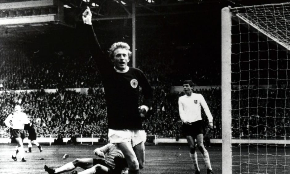 Denis Law memorabilia showing the Aberdeen-born footballer in his iconic pose