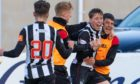 Elgin City's Kane Hester (facing) celebrates after scoring his third goal in the 3-2 midweek win over Queen's Park.