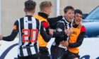 Elgin City's Kane Hester (facing) celebrates after scoring his hat-trick in the 3-2 win over Queen's Park.