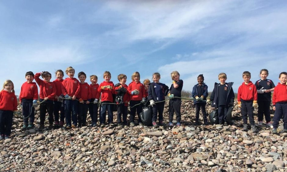 Pupils at Lathallan School in Johnshaven participated in a beach cleanup on Earth Day, one of the many sustainable activities that earned the school a fifth award for environmental education.