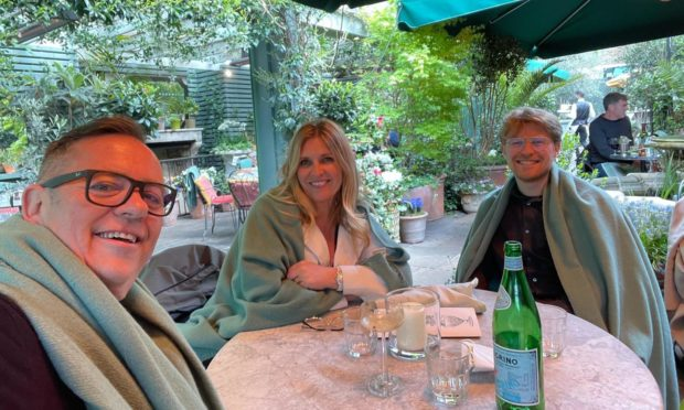 Yvie enjoying a meal at The Ivy with husband Gordon and son Ollie.
