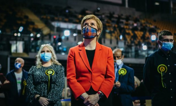 Nicola Sturgeon standing with her campaign team during the 2021 election in Glasgow.