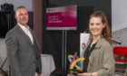 L-R Steve McIntosh, Healthoutfit managing director & Chelsea Page, team leader collecting the award