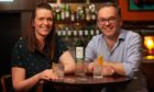 Helen Chalmers and Robert Hicks, of the Highland Liquor Company.