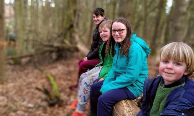 Joseph, Laurie, Tia and Joseph on one of their excursions to the woods.
